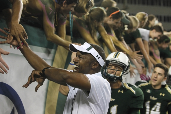 Oct 5, 2013; Tampa, FL, USA; South Florida Bulls head coach Willie Taggart high five fans after they beat the Cincinnati Bearcats during the second half at Raymond James Stadium. South Florida Bulls defeated the Cincinnati Bearcats 26-20. Mandatory Credit: Kim Klement-USA TODAY Sports