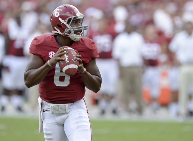 Oct 5, 2013; Tuscaloosa, AL, USA; Alabama Crimson Tide quarterback Blake Sims (6) rolls out looking for a receiver against the Georgia State Panthers during the second quarter at Bryant-Denny Stadium. Mandatory Credit: John David Mercer-USA TODAY Sports