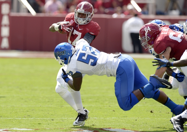 Oct 5, 2013; Tuscaloosa, AL, USA; Alabama Crimson Tide running back Kenyan Drake (17) rushes against Georgia State Panthers defensive lineman Tevin Jones (52) during the second quarter at Bryant-Denny Stadium. Mandatory Credit: John David Mercer-USA TODAY Sports