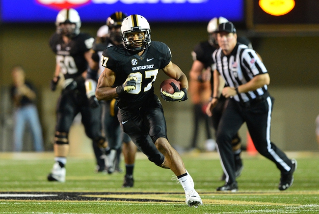 Oct 5, 2013; Nashville, TN, USA; Vanderbilt Commodores wide receiver Jordan Matthews (87) carries the ball after a reception against the Missouri Tigers during the second half at Vanderbilt Stadium. The Tigers beat the Commodores 51-28. Mandatory Credit: Don McPeak-USA TODAY Sports