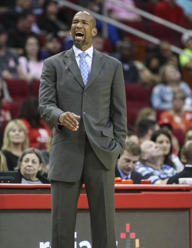 Oct 5, 2013; Houston, TX, USA; New Orleans Pelicans head coach Monty Williams reacts after a play during the third quarter against the Houston Rockets at Toyota Center. Mandatory Credit: Troy Taormina-USA TODAY Sports
