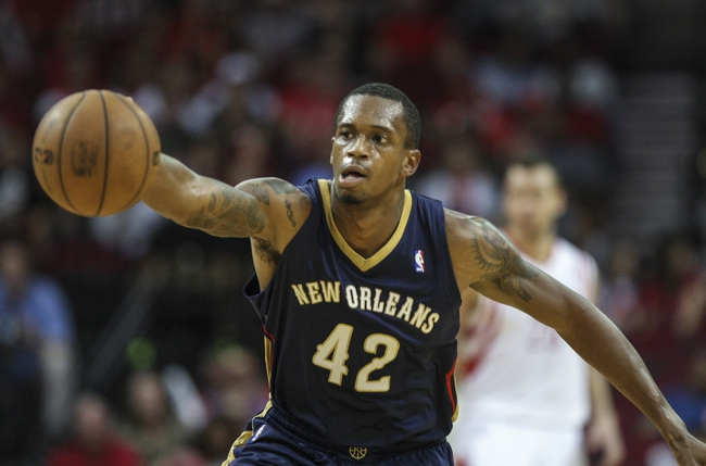 Oct 5, 2013; Houston, TX, USA; New Orleans Pelicans small forward Lance Thomas (42) gets a loose ball during the fourth quarter against the Houston Rockets at Toyota Center. The Pelicans defeated the Rockets 116-115. Mandatory Credit: Troy Taormina-USA TODAY Sports