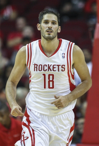 Oct 5, 2013; Houston, TX, USA; Houston Rockets small forward Omri Casspi (18) runs up the court during the fourth quarter against the New Orleans Pelicans at Toyota Center. The Pelicans defeated the Rockets 116-115. Mandatory Credit: Troy Taormina-USA TODAY Sports