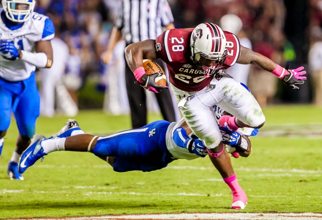 Oct 5, 2013; Columbia, SC, USA; South Carolina Gamecocks running back Mike Davis (28) is tackled by Kentucky Wildcats safety Eric Dixon (28) in the third quarter at Williams-Brice Stadium. Mandatory Credit: Jeff Blake-USA TODAY Sports