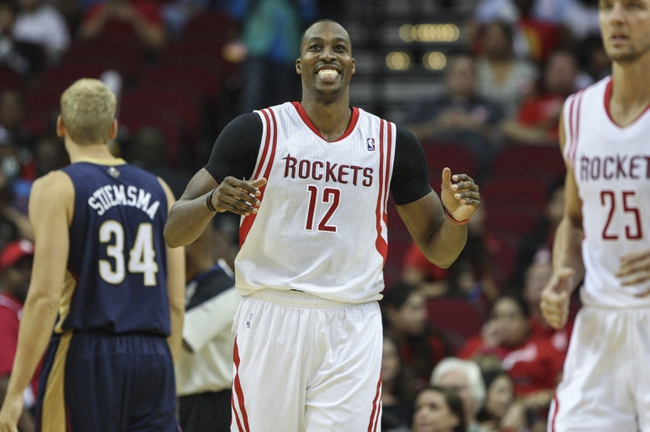 Oct 5, 2013; Houston, TX, USA; Houston Rockets center Dwight Howard (12) reacts after a play during the second quarter against the New Orleans Pelicans at Toyota Center. The Pelicans defeated the Rockets 116-115. Mandatory Credit: Troy Taormina-USA TODAY Sports