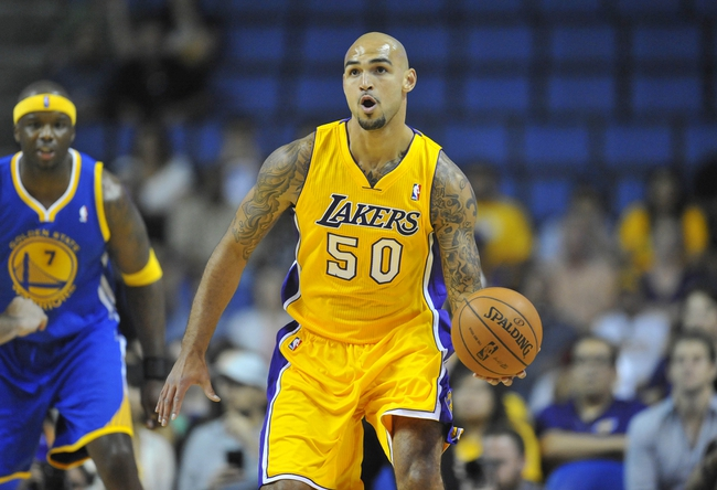 October 5, 2013; Ontario, CA, USA; Los Angeles Lakers center Robert Sacre (50) moves the ball against the Golden State Warriors during the first half at Citizens Business Bank Arena. Mandatory Credit: Gary A. Vasquez-USA TODAY Sports