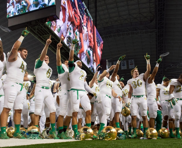 Oct 5, 2013; Arlington, TX, USA; The Notre Dame Fighting Irish sing the Alma Mater after Notre Dame defeated the Arizona State Sun Devils 37-34 at AT&T Stadium. Mandatory Credit: Matt Cashore-USA TODAY Sports