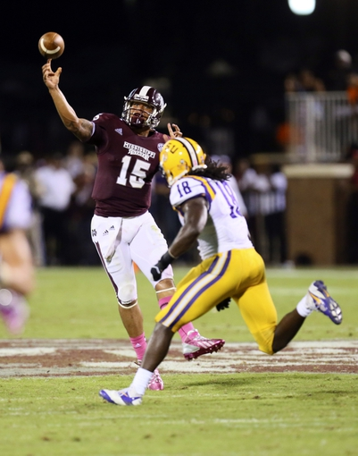 Oct 5, 2013; Starkville, MS, USA; Mississippi State Bulldogs quarterback Dak Prescott (15) passes the ball during the game against the LSU Tigers at Davis Wade Stadium.  LSU Tigers defeated the Mississippi State Bulldogs 59-26.  Mandatory Credit: Spruce Derden-USA TODAY Sports