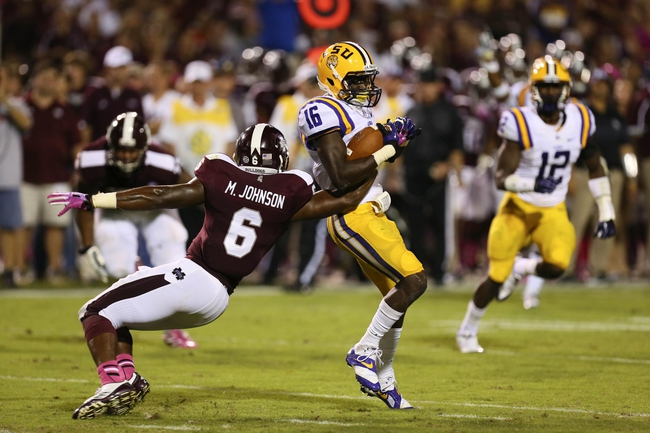 Oct 5, 2013; Starkville, MS, USA; LSU Tigers defensive back Tre'Davious White (16) intercepts the ball and is tackled by Mississippi State Bulldogs tight end Malcolm Johnson (6) during the game at Davis Wade Stadium.  LSU Tigers defeated the Mississippi State Bulldogs 59-26.  Mandatory Credit: Spruce Derden-USA TODAY Sports