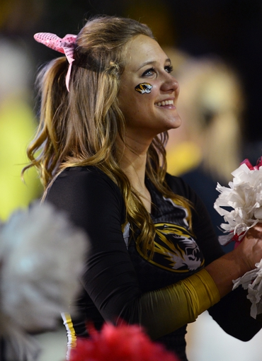 Oct 5, 2013; Nashville, TN, USA; A Missouri Tigers cheerleader performs during the game against the Vanderbilt Commodores during the second half at Vanderbilt Stadium. The Tigers beat the Commodores 51-28. Mandatory Credit: Don McPeak-USA TODAY Sports