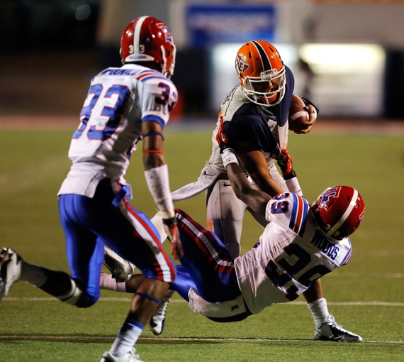 Oct 5, 2013; El Paso, TX, USA; UTEP quarterback Jameill Showers (1) tries to break a tackle from Louisiana Tech Bulldogs defensive back Xavier Woods (39) at Sun Bowl Stadium. Mandatory Credit: Ivan Pierre Aguirre-USA TODAY Sports
