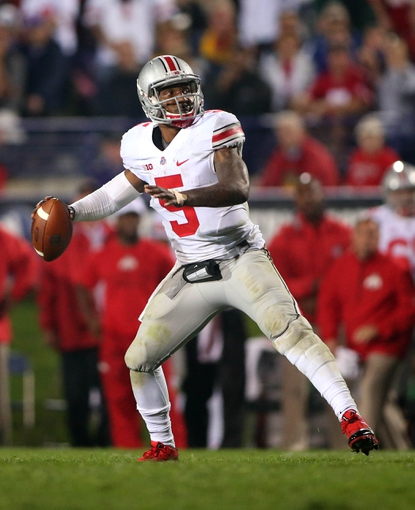 Oct 5, 2013; Evanston, IL, USA; Ohio State Buckeyes quarterback Braxton Miller (5) throws a pass against the Northwestern Wildcats during the fourth quarter at Ryan Field. Ohio State won 40-30. Mandatory Credit: Jerry Lai-USA TODAY Sports