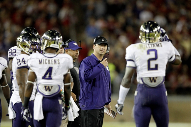Oct 5, 2013; Stanford, CA, USA; Washington Huskies head coach Steve Sarkisian stands on the field during a timeout against the Stanford Cardinal in the second quarter at Stanford Stadium. Mandatory Credit: Cary Edmondson-USA TODAY Sports