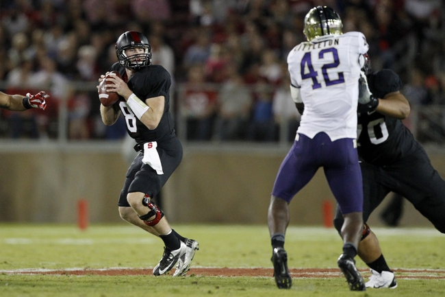 Oct 5, 2013; Stanford, CA, USA; Stanford Cardinal quarterback Kevin Hogan (8) looks to pass the ball against the Washington Huskies in the second quarter at Stanford Stadium. Mandatory Credit: Cary Edmondson-USA TODAY Sports
