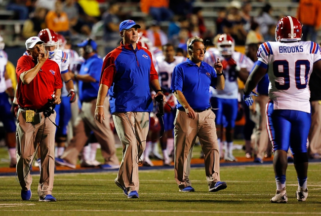 Oct 5, 2013; El Paso, TX, USA; Louisiana Tech Bulldogs head coach Skip Holtz (center) calls his players to the sideline during a time out against the UTEP Miners at Sun Bowl Stadium. Mandatory Credit: Ivan Pierre Aguirre-USA TODAY Sports