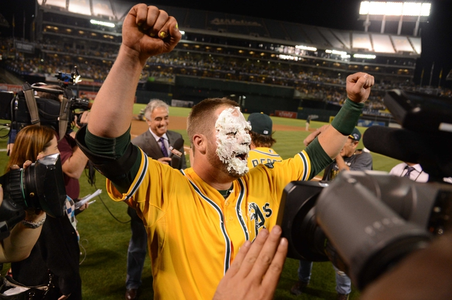 October 5, 2013; Oakland, CA, USA; Oakland Athletics catcher Stephen Vogt (21) receives a pie from right fielder Josh Reddick (16, not pictured) after game two of the American League divisional series playoff baseball game against the Detroit Tigers at O.co Coliseum. The Athletics defeated the Tigers 1-0. Mandatory Credit: Kyle Terada-USA TODAY Sports
