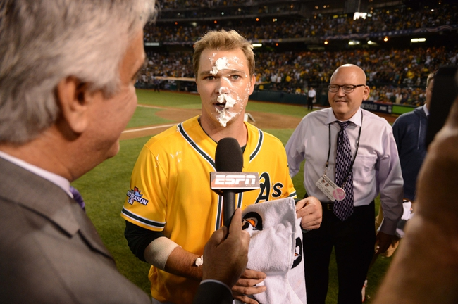 October 5, 2013; Oakland, CA, USA; Oakland Athletics starting pitcher Sonny Gray (54) receives a pie while being interviewed by ESPN after game two of the American League divisional series playoff baseball game against the Detroit Tigers at O.co Coliseum. The Athletics defeated the Tigers 1-0. Mandatory Credit: Kyle Terada-USA TODAY Sports