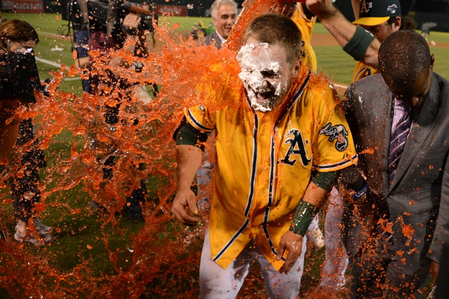 October 5, 2013; Oakland, CA, USA; Oakland Athletics catcher Stephen Vogt (21) receives a gatorade bath during a TV interview after game two of the American League divisional series playoff baseball game against the Detroit Tigers at O.co Coliseum. The Athletics defeated the Tigers 1-0. Mandatory Credit: Kyle Terada-USA TODAY Sports