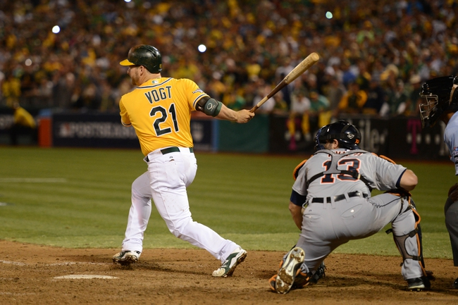 October 5, 2013; Oakland, CA, USA; Oakland Athletics catcher Stephen Vogt (21) hits the game-winning single to score left fielder Yoenis Cespedes (52, not pictured) during the ninth inning in game two of the American League divisional series playoff baseball game against the Detroit Tigers at O.co Coliseum. The Athletics defeated the Tigers 1-0. Mandatory Credit: Kyle Terada-USA TODAY Sports