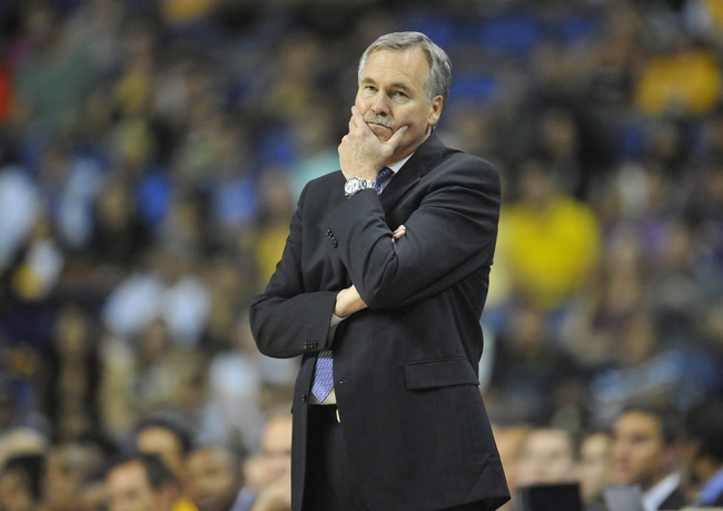 October 5, 2013; Ontario, CA, USA; Los Angeles Lakers head coach Mike D'Antoni watches game action against the Golden State Warriors during the second half at Citizens Business Bank Arena. Mandatory Credit: Gary A. Vasquez-USA TODAY Sports