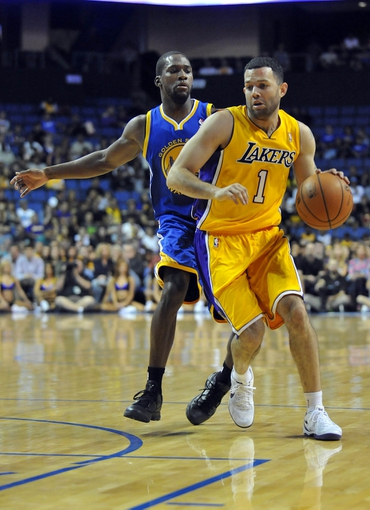 October 5, 2013; Ontario, CA, USA; Los Angeles Lakers point guard Jordan Farmar (1) moves the ball against the Golden State Warriors during the second half at Citizens Business Bank Arena. Mandatory Credit: Gary A. Vasquez-USA TODAY Sports