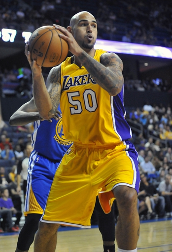 October 5, 2013; Ontario, CA, USA; Los Angeles Lakers center Robert Sacre (50) controls the ball against the Golden State Warriors during the second half at Citizens Business Bank Arena. Mandatory Credit: Gary A. Vasquez-USA TODAY Sports
