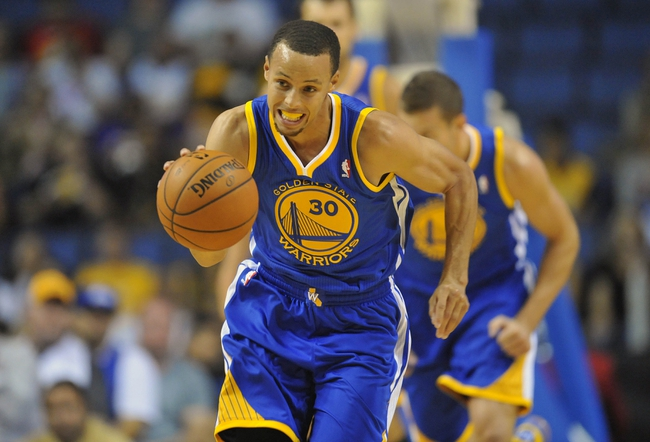 October 5, 2013; Ontario, CA, USA; Golden State Warriors point guard Stephen Curry (30) moves the ball up court against the Los Angeles Lakers during the first half at Citizens Business Bank Arena. Mandatory Credit: Gary A. Vasquez-USA TODAY Sports