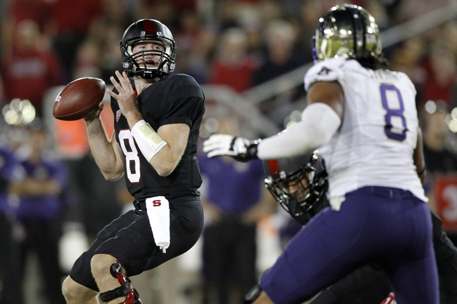 Oct 5, 2013; Stanford, CA, USA; Stanford Cardinal quarterback Kevin Hogan (8) looks to pass the ball against the Washington Huskies in the third quarter at Stanford Stadium. The Cardinal defeated the Huskies 31-28. Mandatory Credit: Cary Edmondson-USA TODAY Sports