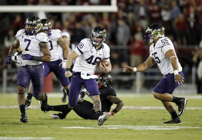 Oct 5, 2013; Stanford, CA, USA; Washington Huskies punter Travis Coons (46) picks up a first down on a fake punt against the Stanford Cardinal in the third quarter at Stanford Stadium. The Cardinal defeated the Huskies 31-28. Mandatory Credit: Cary Edmondson-USA TODAY Sports