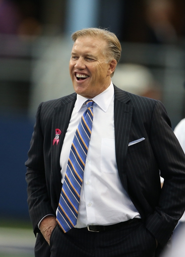 Oct 6, 2013; Arlington, TX, USA; Denver Broncos executive vice president of football operations John Elway on the field prior to the game against the Dallas Cowboys at AT&T Stadium. Mandatory Credit: Matthew Emmons-USA TODAY Sports