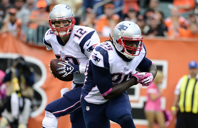 Oct 6, 2013; Cincinnati, OH, USA; New England Patriots quarterback Tom Brady (12) holds the ball after a fake hand off to 