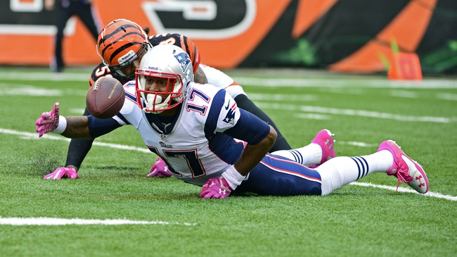 Oct 6, 2013; Cincinnati, OH, USA; New England Patriots wide receiver Aaron Dobson (17) reaches to grab a ball that he fumbled in the second half of the game against the Cincinnati Bengals at Paul Brown Stadium. The Bengals won 13-6.  Mandatory Credit: Marc Lebryk-USA TODAY Sports