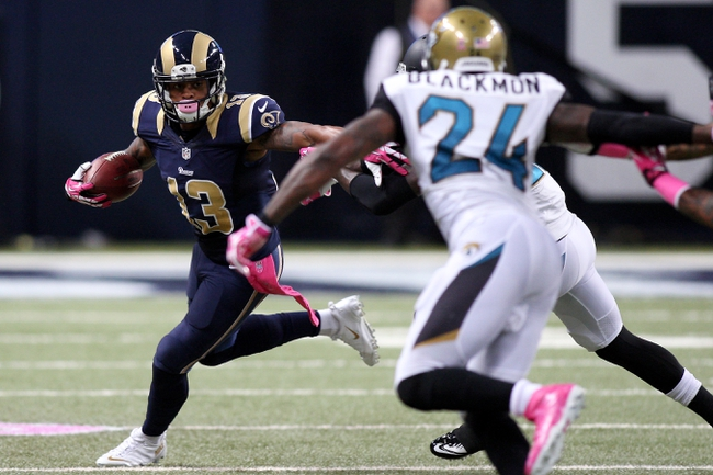 Oct 6, 2013; St. Louis, MO, USA; St. Louis Rams wide receiver Chris Givens (13) carries the ball while under pressure from Jacksonville Jaguars cornerback Will Blackmon (24) during the second half at The Edward Jones Dome. Mandatory Credit: Scott Kane-USA TODAY Sports