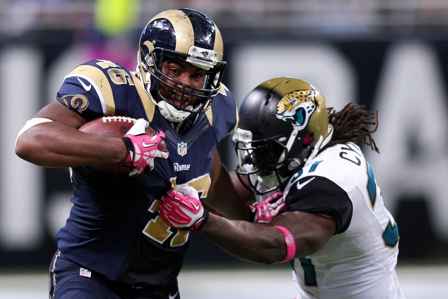 Oct 6, 2013; St. Louis, MO, USA; St. Louis Rams tight end Cory Harkey (46) carries the ball while under pressure from Jacksonville Jaguars strong safety John Cyprien (37) during the second half at The Edward Jones Dome. Mandatory Credit: Scott Kane-USA TODAY Sports