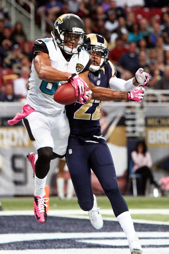 Oct 6, 2013; St. Louis, MO, USA; Jacksonville Jaguars wide receiver Cecil Shorts (84) catches a pass for a touchdown while under pressure from St. Louis Rams cornerback Trumaine Johnson (22) during the second half at The Edward Jones Dome. Mandatory Credit: Scott Kane-USA TODAY Sports