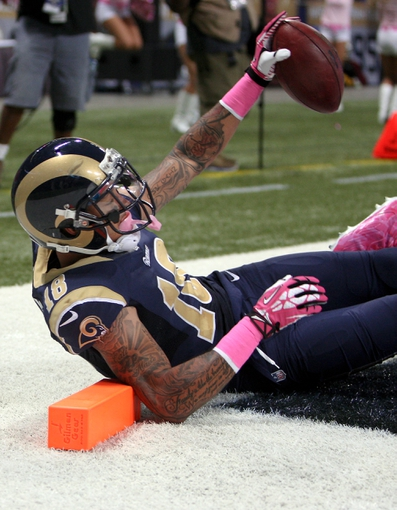 Oct 6, 2013; St. Louis, MO, USA; St. Louis Rams wide receiver Austin Pettis (18) catches for a touchdown during the fourth quarter against the Jacksonville Jaguars at The Edward Jones Dome. Mandatory Credit: Scott Kane-USA TODAY Sports