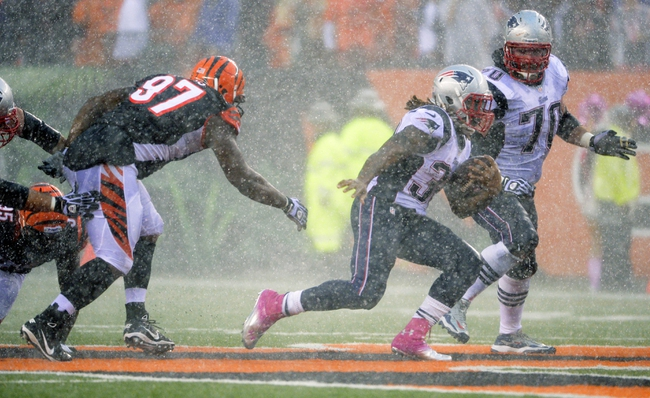 Oct 6, 2013; Cincinnati, OH, USA; New England Patriots running back Brandon Bolden (38) tries to get away from Cincinnati Bengals defensive tackle Geno Atkins (97) during the second half at Paul Brown Stadium. The Bengals won 13-6.  Mandatory Credit: Marc Lebryk-USA TODAY Sports