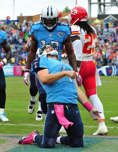 Oct 6, 2013; Nashville, TN, USA; Tennessee Titans quarterback Ryan Fitzpatrick (4) celebrates after scoring a touchdown against the Kansas City Chiefs during the second half at LP Field. The Chiefs beat the Titans 26-17. Mandatory Credit: Don McPeak-USA TODAY Sports