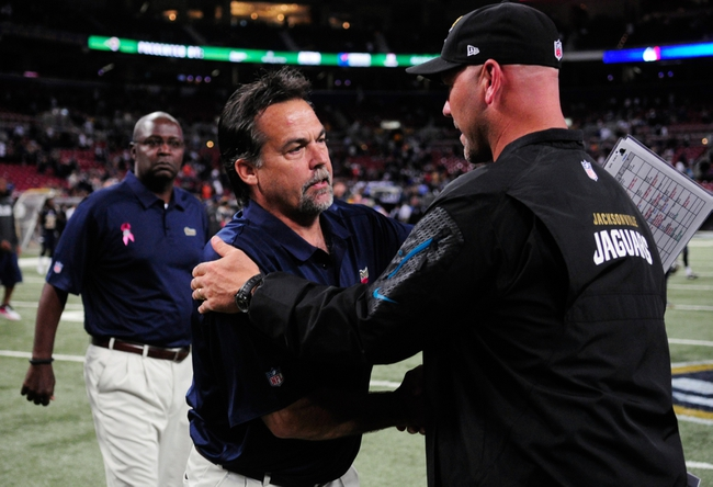 Oct 6, 2013; St. Louis, MO, USA; St. Louis Rams head coach Jeff Fisher greets Jacksonville Jaguars head coach Gus Bradley after a game at the Edward Jones Dome. St. Louis defeated Jacksonville 34-20. Mandatory Credit: Jeff Curry-USA TODAY Sports