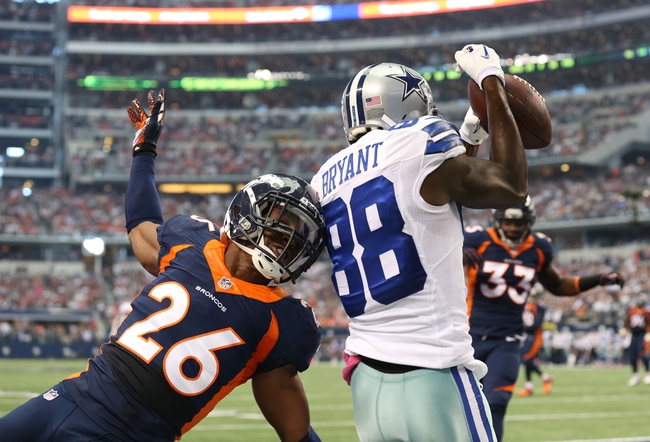 Oct 6, 2013; Arlington, TX, USA; Dallas Cowboys receiver Dez Bryant (88) catches a first quarter touchdown against Denver Broncos safety Rahim Moore (26) at AT&T Stadium. Mandatory Credit: Matthew Emmons-USA TODAY Sports