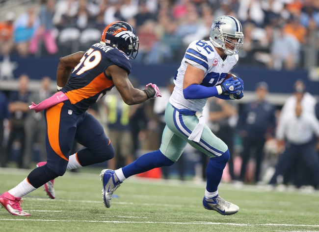 Oct 6, 2013; Arlington, TX, USA; Dallas Cowboys tight end Jason Witten (82) runs after a reception against Denver Broncos linebacker Danny Trevathan (59) in the first quarter at AT&T Stadium. Mandatory Credit: Matthew Emmons-USA TODAY Sports