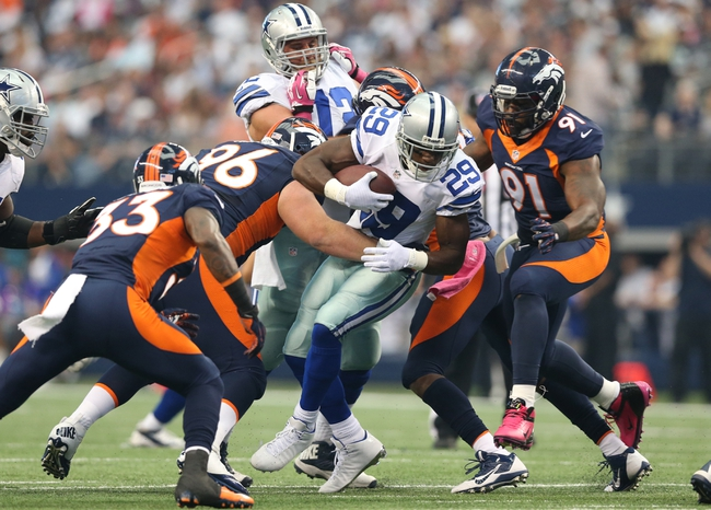 Oct 6, 2013; Arlington, TX, USA; Dallas Cowboys running back DeMarcus Murray (29) runs with the ball against Denver Broncos defensive tackle Mitch Unrein (96) and defensive end Robert Ayers (91) in the first quarter  at AT&T Stadium. Mandatory Credit: Matthew Emmons-USA TODAY Sports