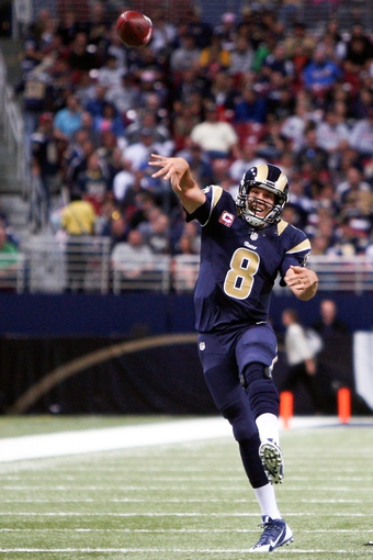 Oct 6, 2013; St. Louis, MO, USA; St. Louis Rams quarterback Sam Bradford (8) passes the ball during the second half against the Jacksonville Jaguars at The Edward Jones Dome. Mandatory Credit: Scott Kane-USA TODAY Sports