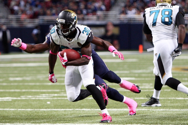 Oct 6, 2013; St. Louis, MO, USA; Jacksonville Jaguars running back Jordan Todman (30) carries the ball during the second half against the St. Louis Rams at The Edward Jones Dome. Mandatory Credit: Scott Kane-USA TODAY Sports