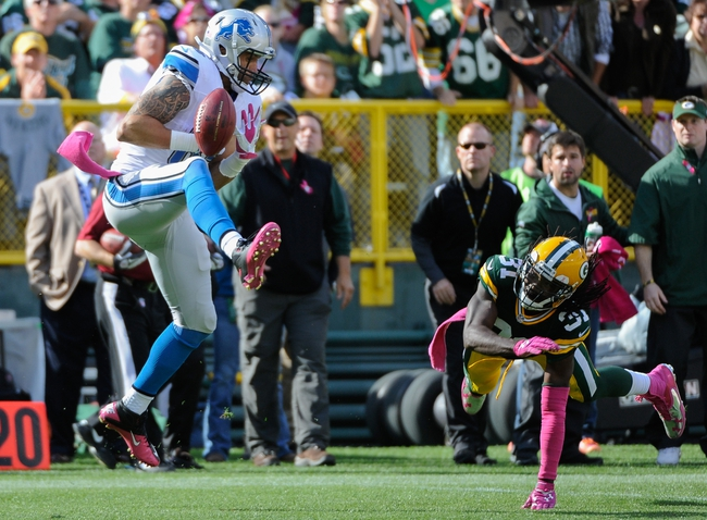 Oct 6, 2013; Green Bay, WI, USA; Detroit Lions tight end Tony Scheffler (85) can't hold onto ball while covered by Green Bay Packers cornerback Davon House (31) in the 4th quarter at Lambeau Field. The Packers won 22-9. Mandatory Credit: Benny Sieu-USA TODAY Sports