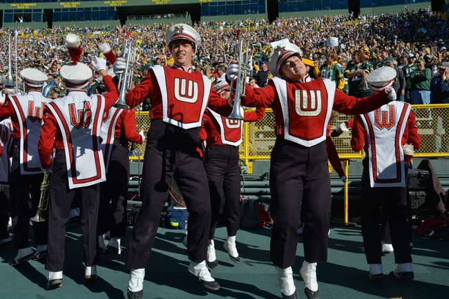 Oct 6, 2013; Green Bay, WI, USA; The University of Wisconsin marching band celebrates a 22-9 win by the Green Bay Packers over the Detroit Lions at Lambeau Field. Mandatory Credit: Benny Sieu-USA TODAY Sports
