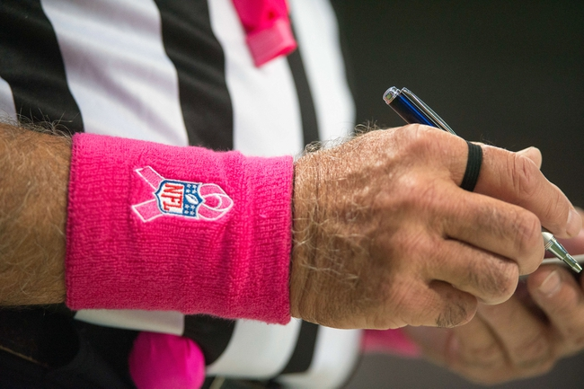 Oct 6, 2013; St. Louis, MO, USA; NFL officials wear pink for breast cancer awareness month during a game between the St. Louis Rams and the Jacksonville Jaguars at the Edward Jones Dome. St. Louis defeated Jacksonville 34-20. Mandatory Credit: Jeff Curry-USA TODAY Sports