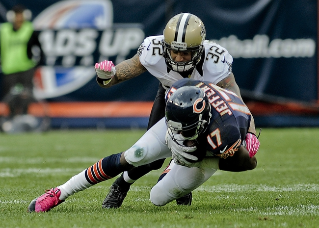 Oct 6, 2013; Chicago, IL, USA; Chicago Bears wide receiver Alshon Jeffery (17) hauls in a pass while being guarded by New Orleans Saints strong safety Kenny Vaccaro (32) during the second half at Soldier Field.  Mandatory Credit: Matt Marton-USA TODAY Sports