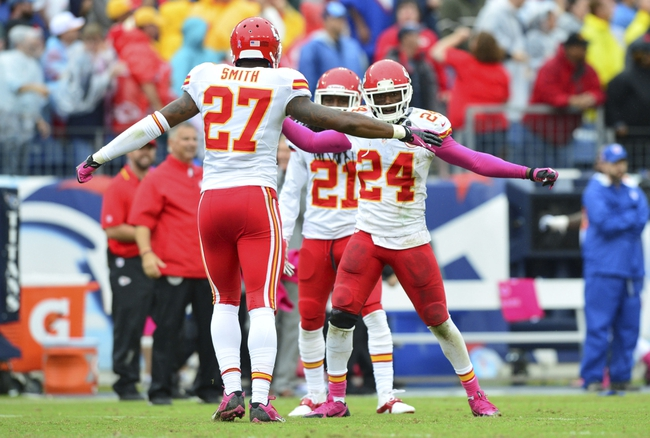 Oct 6, 2013; Nashville, TN, USA;  Kansas City Chiefs cornerback Sean Smith (27) and cornerback Brandon Flowers (24) celebrate a win over the Tennessee Titans at LP Field. The Chiefs beat the Titans 26-17. Mandatory Credit: Don McPeak-USA TODAY Sports