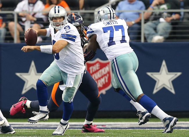 Oct 6, 2013; Arlington, TX, USA; Dallas Cowboys quarterback Tony Romo (9) scrambles in the second quarter against the Denver Broncos at AT&T Stadium. Mandatory Credit: Matthew Emmons-USA TODAY Sports